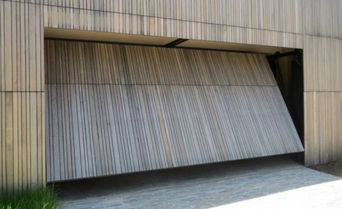 Portoni A Due Ante Per Garage Usato.Quanto Costa Porta Basculante Garage Edilnet It